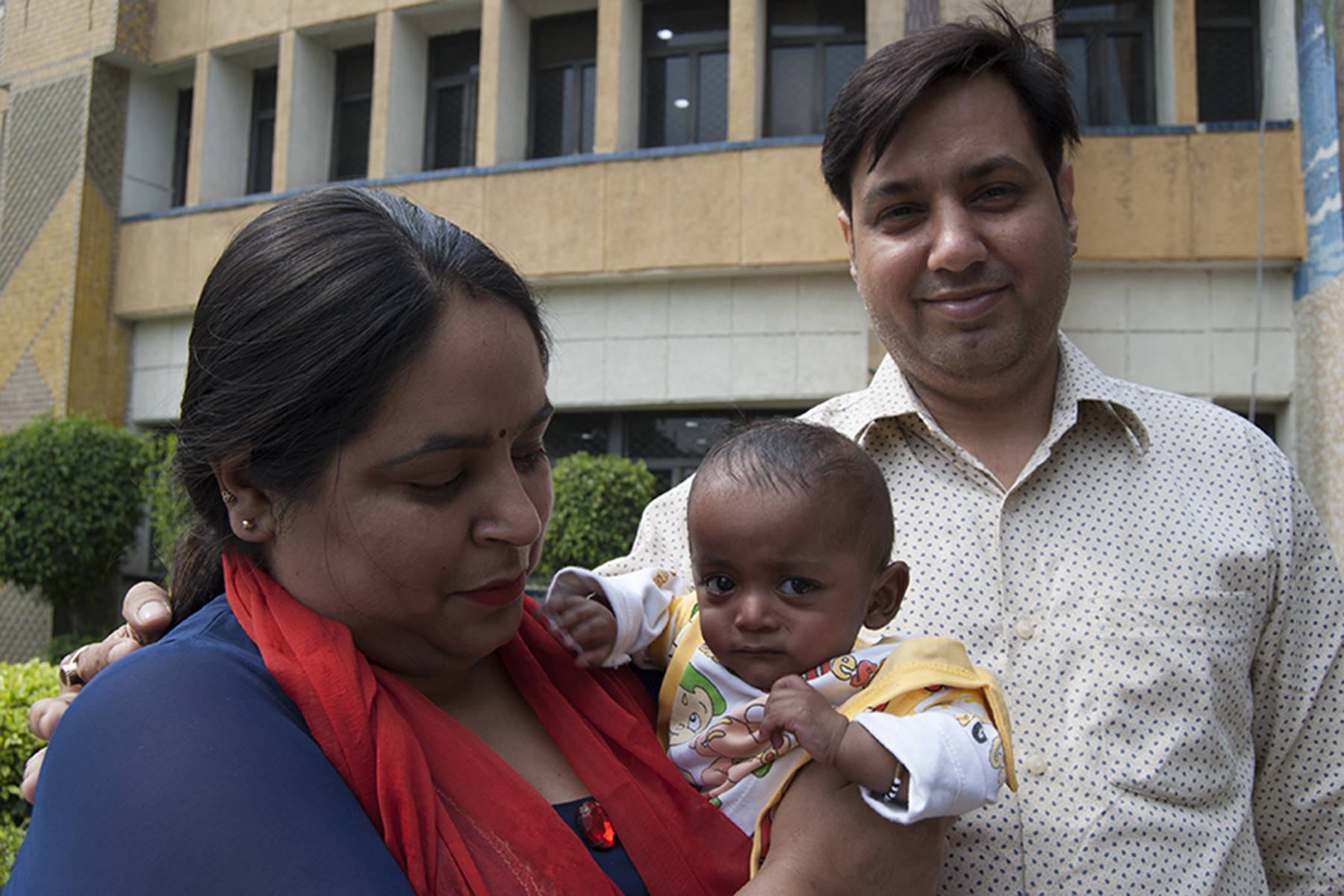 Anu Bhalla, mom, Pawan Bhalla dad, and baby Naksh Bhalla. The baby is the surviving one of two twins born prematurely. He successfully fought off a drug-resistant infection.