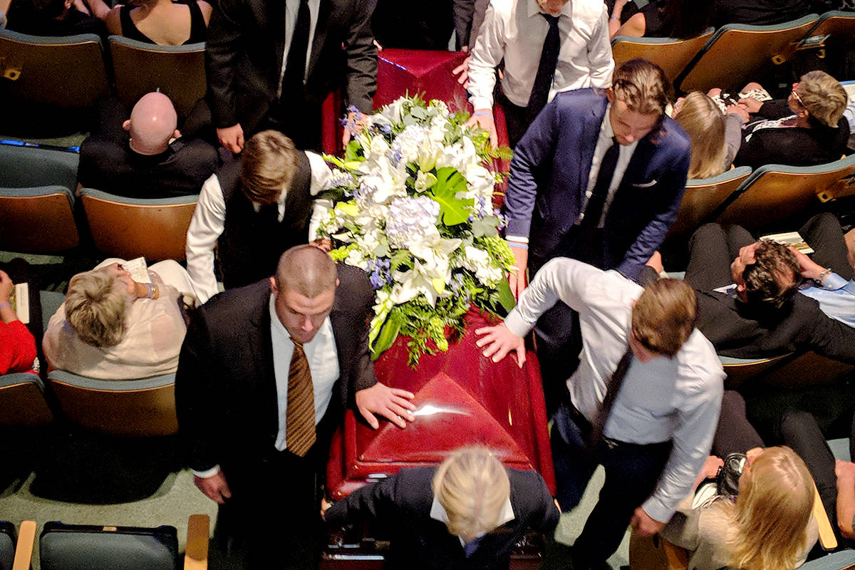 Jack Stroud's friends and family help remove Jack's casket from the church Wednesday. (Aaron Hinks photo)